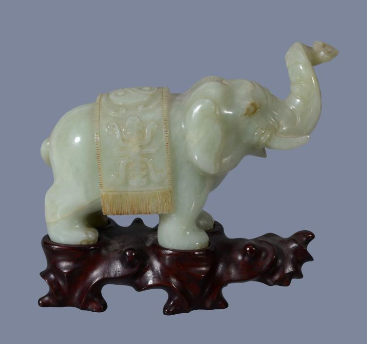 A Chinese celadon jade elephant , the saddle carved with Shou characters...