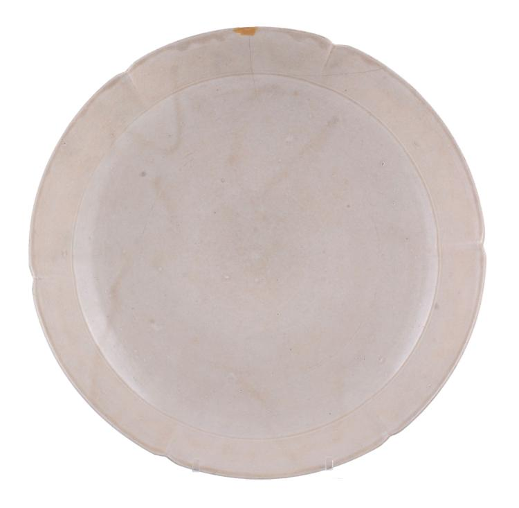 A Chinese finely potted six-lobed white stoneware dish