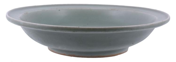 A Chinese celadon bowl, Song-Yuan Dynasty, with a translucent green glaze