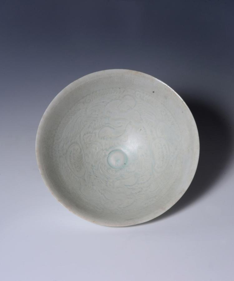 A Chinese carved Qingbai 'Boys' bowl , Southern Song Dynasty , of conical form