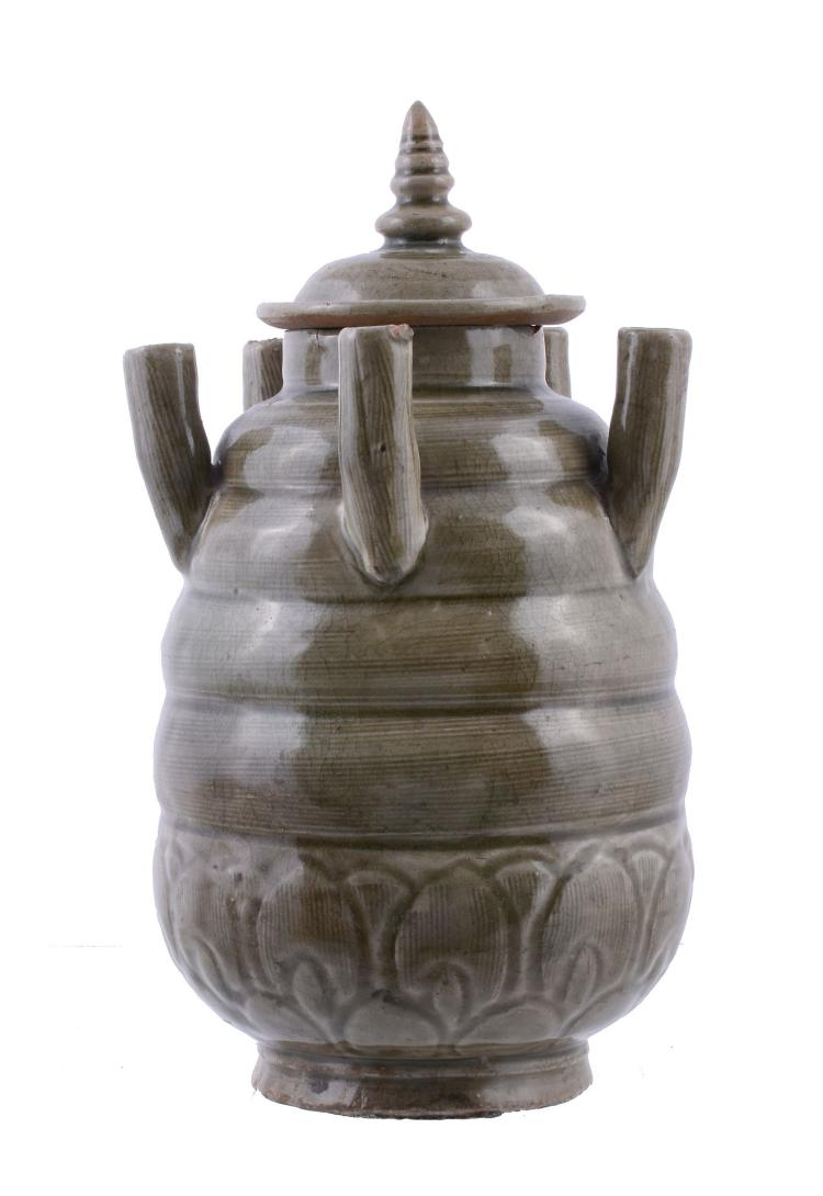 A Chinese Longquan celadon glazed carved jar and cover , Song Dynasty