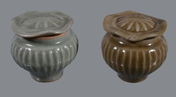 Two Chinese Longquan celadon jars and covers , probably Song-Yuan Dynasty