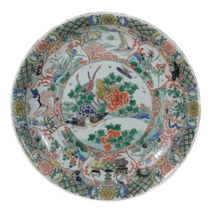 A Chinese Famille Verte Dish, Kangxi, painted with landscape panels round a...