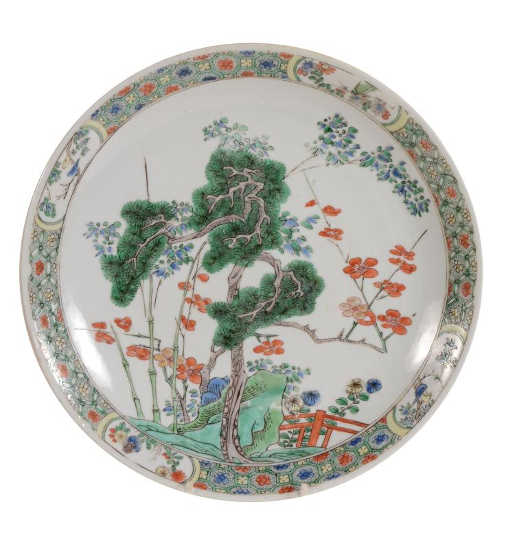 A Chinese Famille Verte dish , Kangxi, decorated to the centre with the...