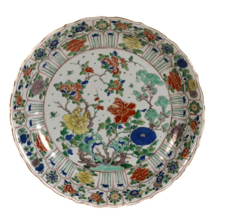 A Chinese Famille Verte Dish, Kangxi, painted with flowering peony and...