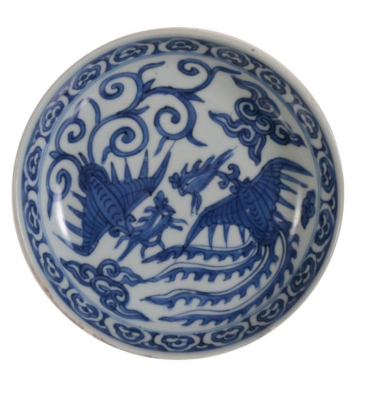 A small Chinese blue and white 'Phoenix' dish, 17th century