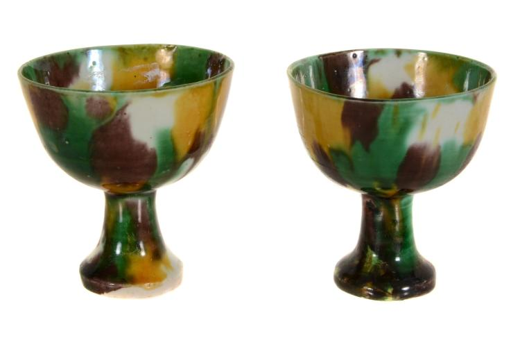 A pair of Chinese 'egg and spinach' stem cups, Kangxi, hu pi