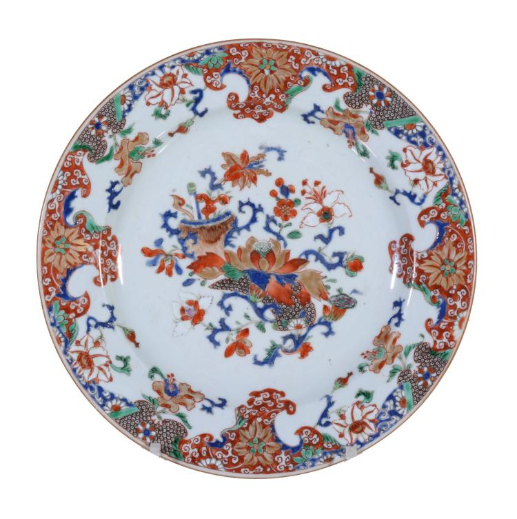 A Chinese Famille Rose plate, Qianlong, painted with a cornucopia of...