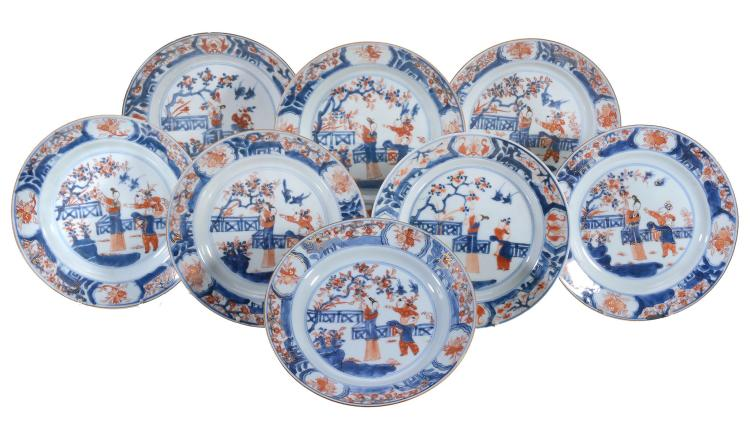 Eight Chinese Imari Plates , Kangxi, painted with figures on a terrace with...