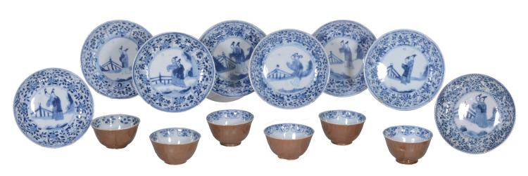 A set of six tea bowls and eight saucers, 18th century or later
