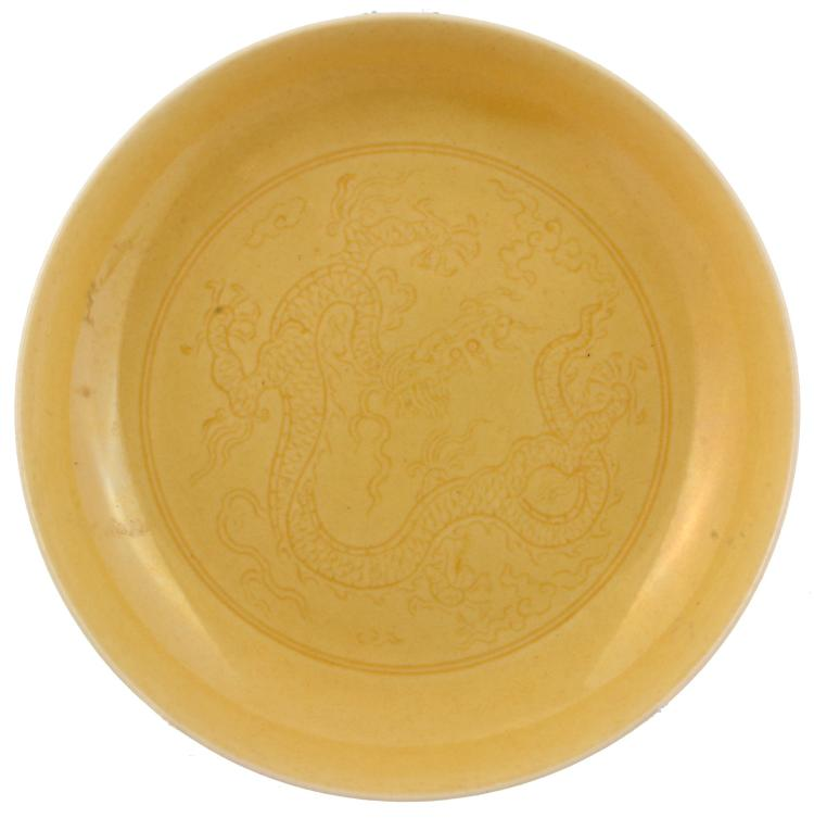 A small Chinese yellow monochrome' Dragon' dish, possibly Qing Dynasty