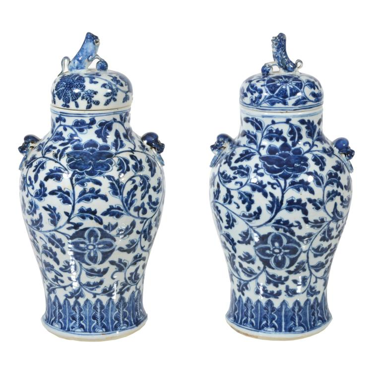 A pair of Chinese blue and white vases and covers , 19 th century