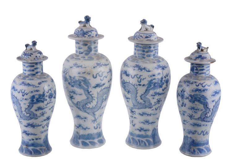 A pair of Chinese blue and white 'Dragon' vases and covers, late Qing Dynasty