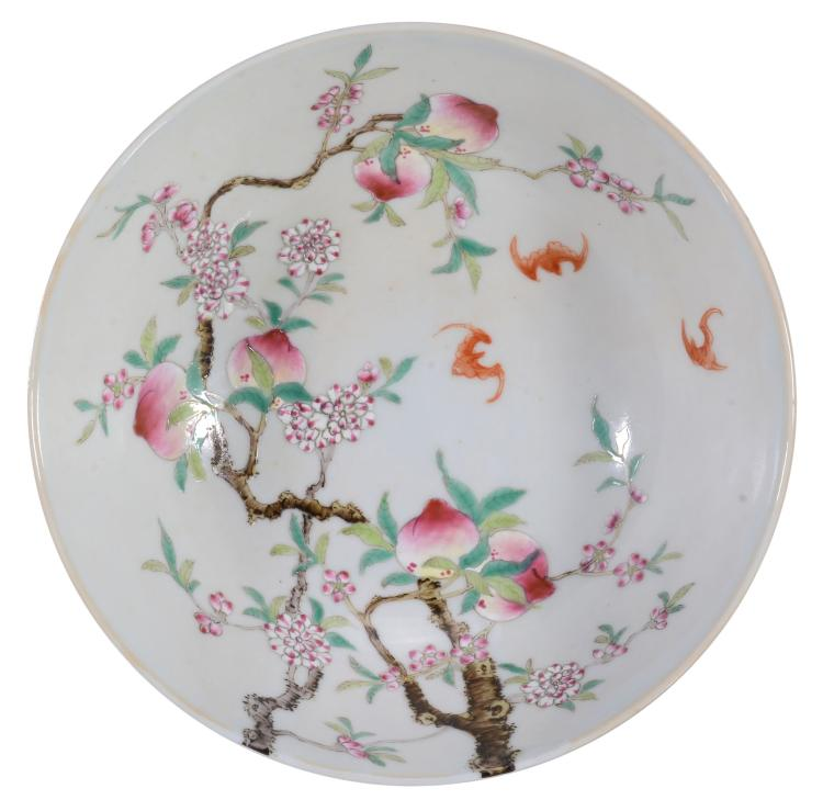 A Chinese 'Peaches and Bats' bowl, decorated with bats in flight above...