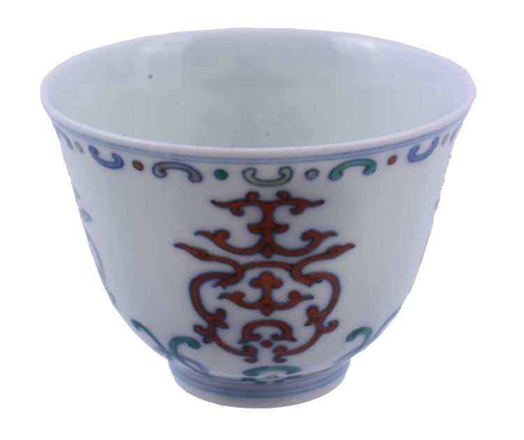 A Chinese Doucai tea bowl, painted with a strapwork design