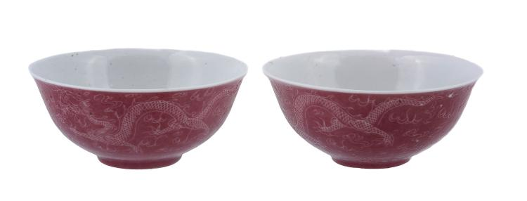 A pair of Chinese pink glazed 'dragon' bowls, possibly Republican Period