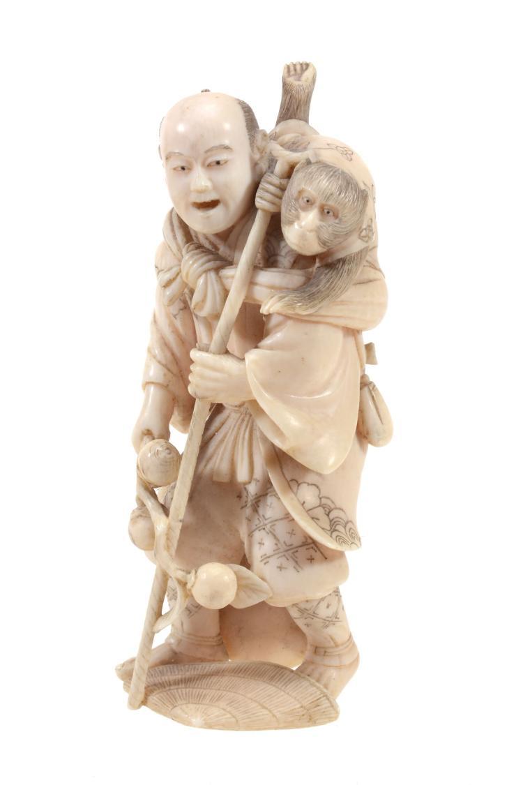 A Japanese Ivory Okimono of a Sarumawashi