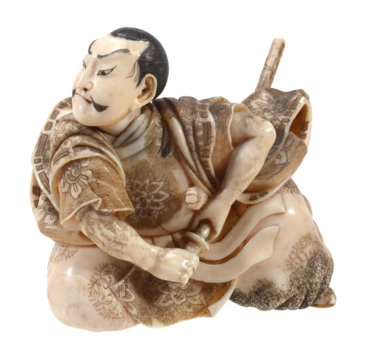 A Japanese Walrus Ivory Okimono of a Samurai