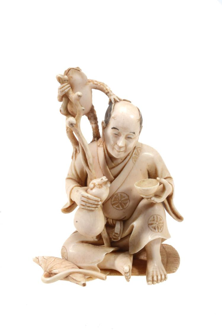 An Ivory Okimono of a Man seated on a mat with one knee raised