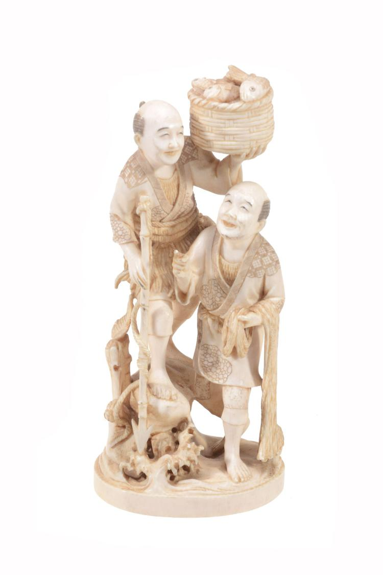 An Ivory Okimono of Two Fishermen , the two smiling figures perch on a rocky...