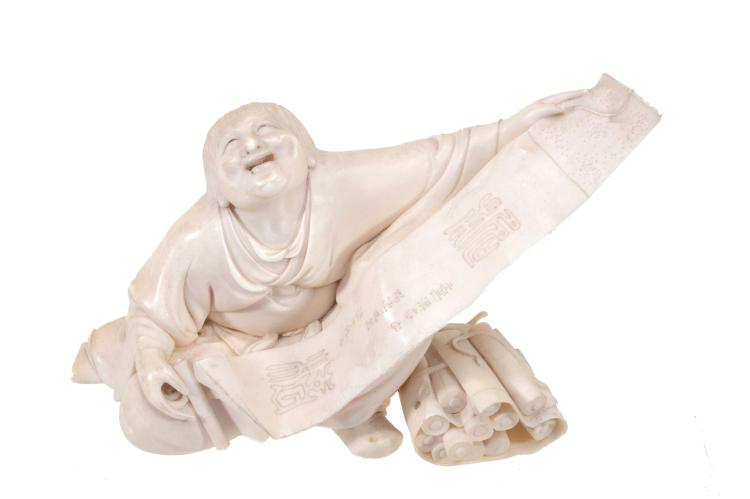 A Fine Tokyo School Ivory Okimono of a seated figure with its face lifted in...