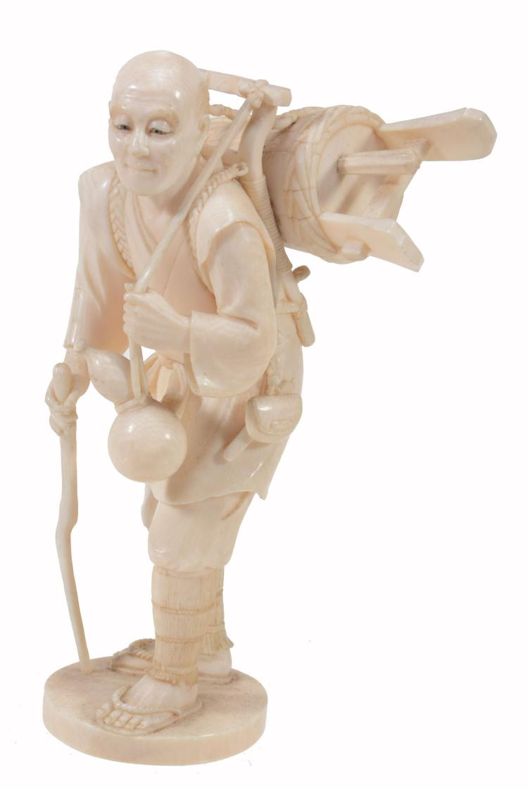 A Japanese Ivory Okimono of a Sake Seller