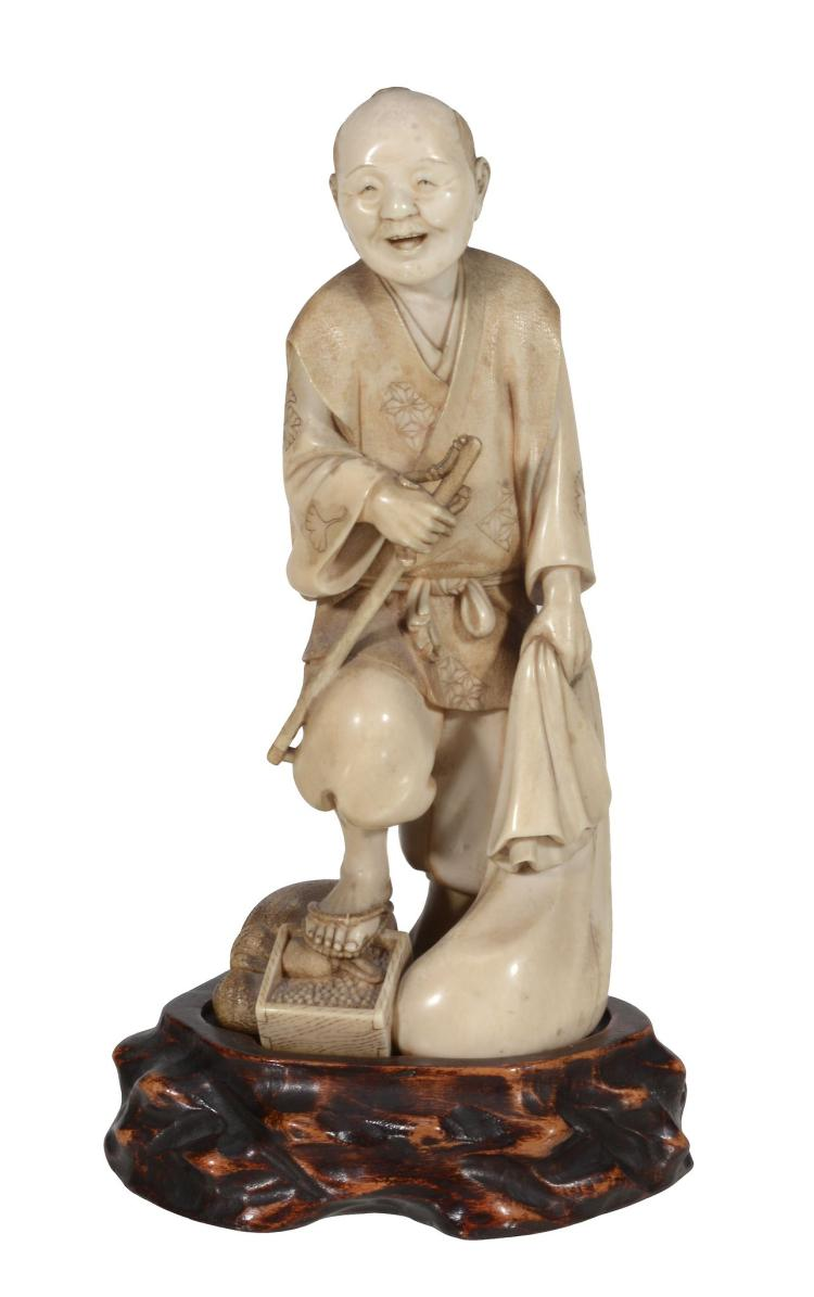 A Good Japanese Ivory Okimono carved as a street seller