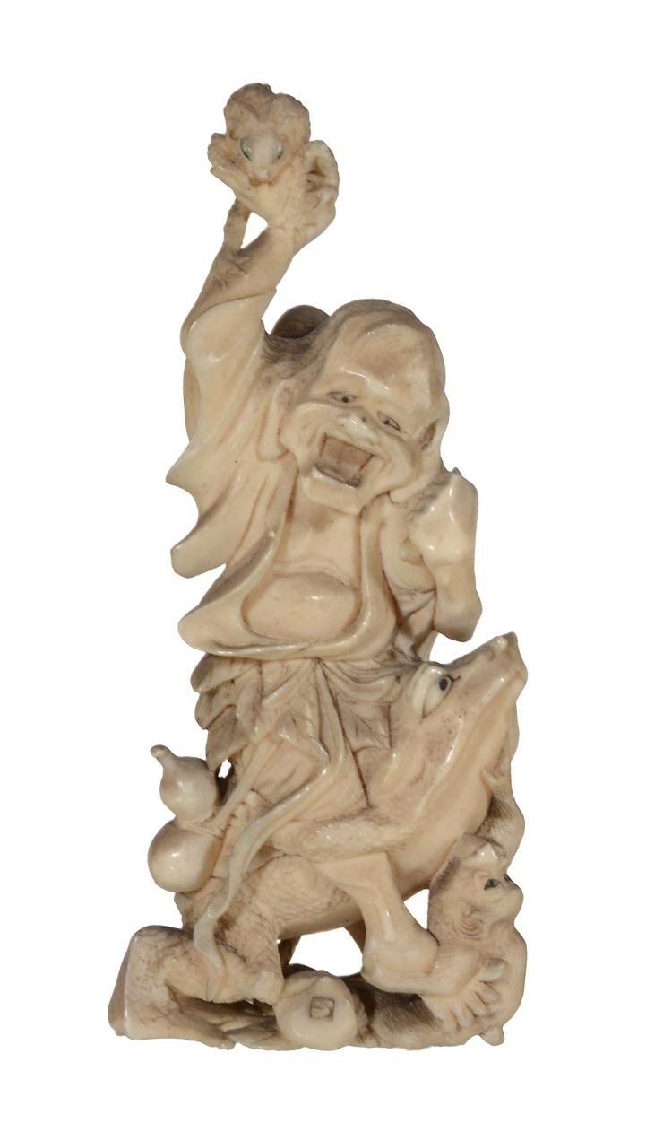 A Japanese Ivory Okimono of a figure probably intended as Gama Sennin