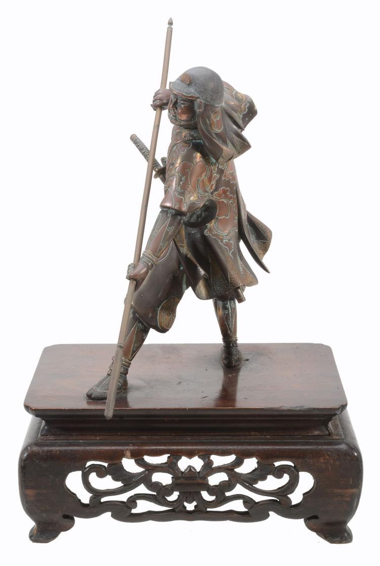 A Japanese bronze figure of a Samurai , in Miyao style