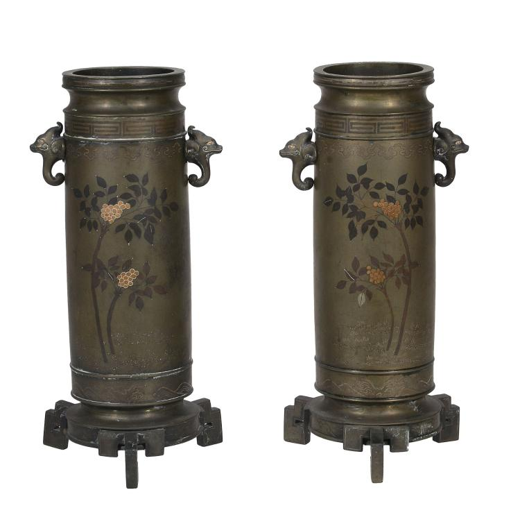 A Pair of Bronze Vases, each of cylindrical form with animal head handles...