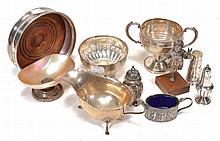 A small collection of silver, including: an oval sauce boat on three scroll...