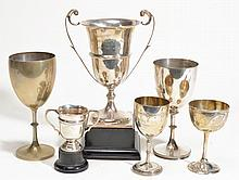 Four silver and two electro-plated trophy cups, two with bases