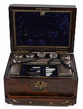 A rose wood and marquetry dressing case, opening to ten cut glass bottles...