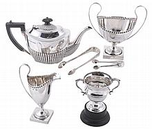 A collection of silver, to include: a silver oval tea pot by Joseph Rodgers...