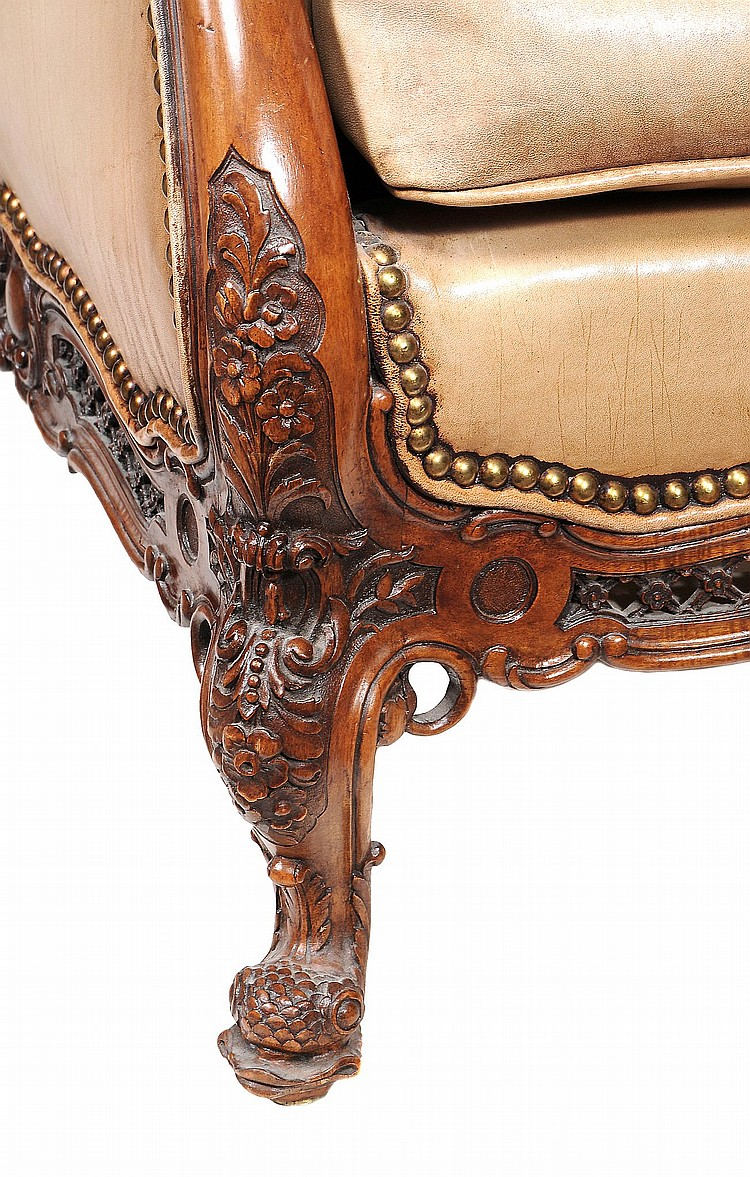 A Pair Of French Carved Walnut And Buttoned Leather Upholste