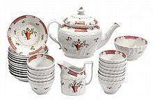 An English porcelain spirally fluted part tea