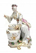 A Chelsea chinoiserie bouquetiere figure of a
