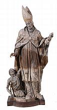 A Continental sculpted limewood group of a Saint