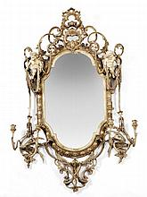 A Continental giltwood and composition mirror,