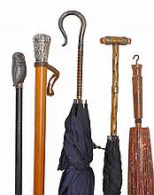 A collection of walking sticks and parasols, 19th