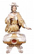 An Italian carved, painted and parcel giltwood