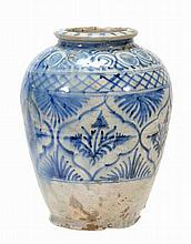 A Middle Eastern pottery jar of tapered ovoid form