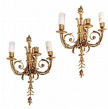 A pair of gilt metal three light wall appliques in
