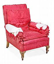 A carved giltwood and damask upholstered armchair