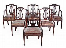 A set of six mahogany elbow chairs, in George III