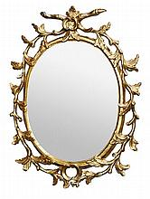 A George III carved giltwood oval wall mirror,