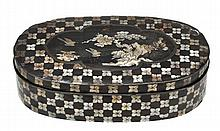 A Chinese lacquer box and cover of oval form,