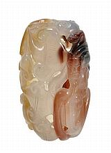 An agate handling piece of rounded form pierced