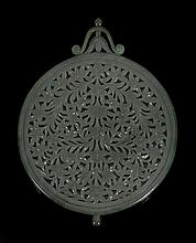 A Moghul jade mirror, 18th-19th century , carved on the back in openwork...