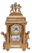 A French porcelain inset gilt metal mantel clock,